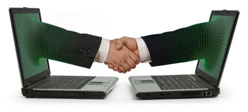 Two facing laptops with an arm emerging from each screen and shaking hands on a white background